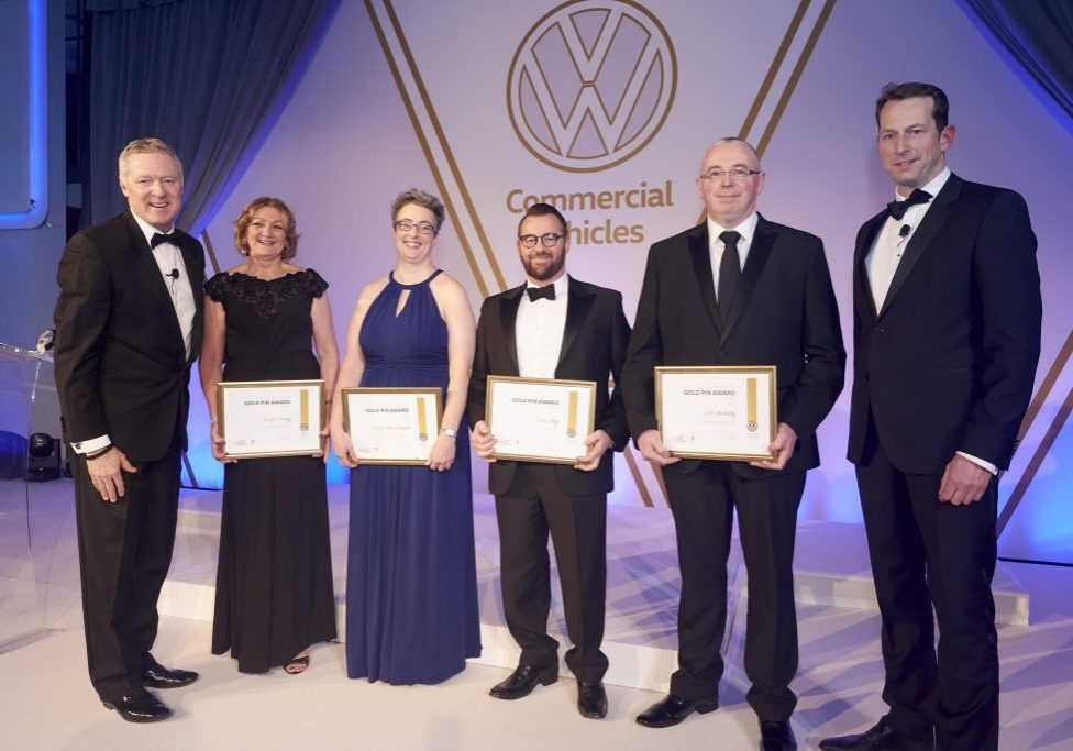 Donnelly Group is celebrating after a fourth member of its award-winning team received the prestigious Volkswagen Gold Pin for outstanding services to and commitment to the brand. Lesley Ann Cunnah, third from left, Site Director at Donnelly Group Volkswagen in Eglinton received the honour, in recognition of her dedication to the manufacturer's commercial vehicles, at a glittering ceremony in London last month. She is pictured with fellow recipients from across the UK, alongside event host Rory Bremner, far left, and Carl zu Dohna, far right, Director of Volkswagen Commercial Vehicles UK.