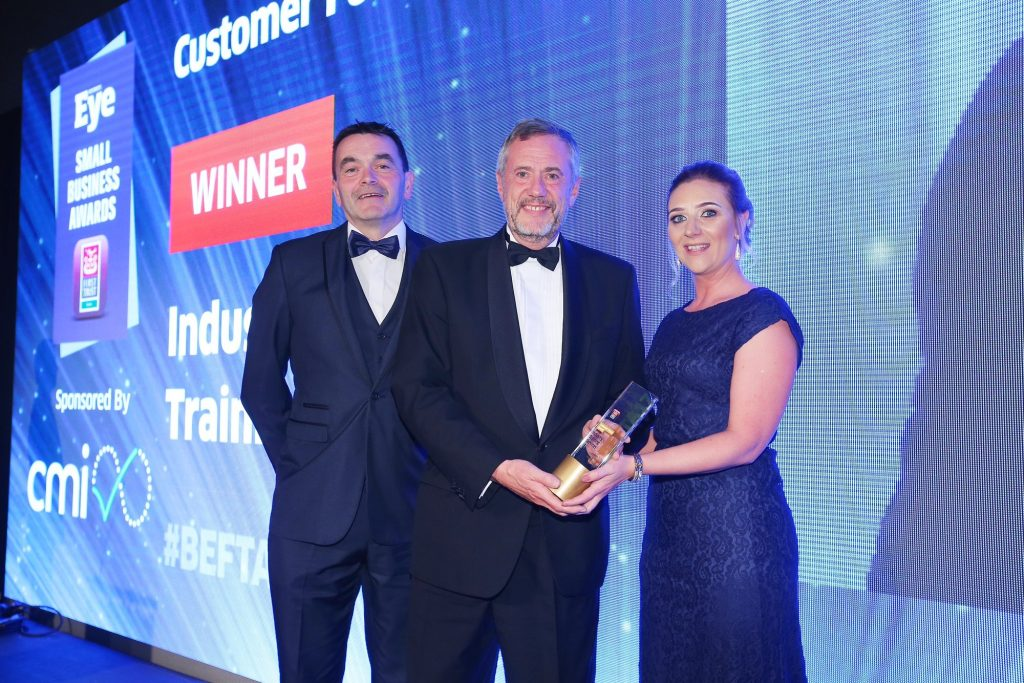 Industry Training Services (ITS) Managing Director Brendan Crealey, left, and Sales Manager Ciara Judge receive the Customer Focus Award at the Business Eye First Trust Bank Small Business Awards from Ken Roulston, Managing Director of category sponsor CMI. Judges were impressed by ITS' efforts to tailor its offering to suit the particular needs of clients. The company has invested more than £150,000 in the past 18 months to enhance its facilities including moving to new purpose-built premises on a 10-acre site off the M1 Motorway. And ITS has also recently launched a National Construction Skills Academy in response to calls from clients to plug a skills gap in the construction sector.