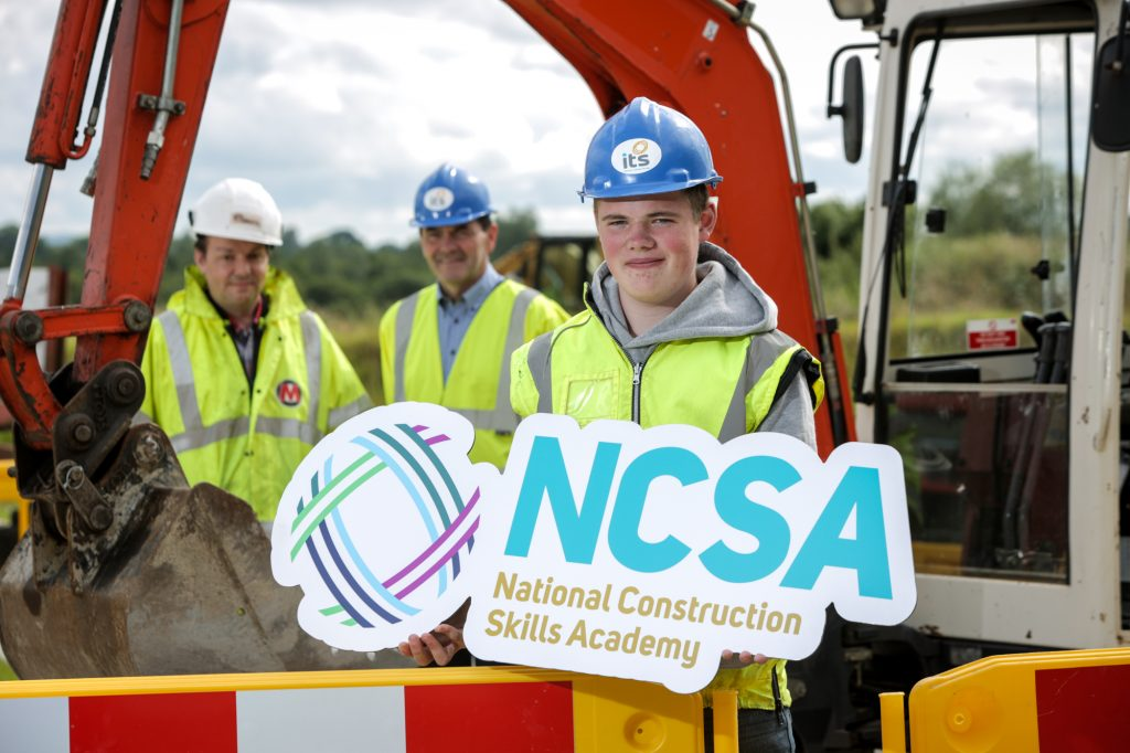 Eoin McDowell (16) from Lurgan gets ready for the first term of the new National Construction Skills Academy at Industry Training Services (ITS) in Portadown with Terry McCrum, Morrow Contracts, and Brendan Crealey, ITS. The Academy will provide 10 jobs for the first intake of students on its unique groundworkers course commencing in September. For more information or to apply for a place, contact 028 3839 8700 or visit www.ncskillsacademy.com.