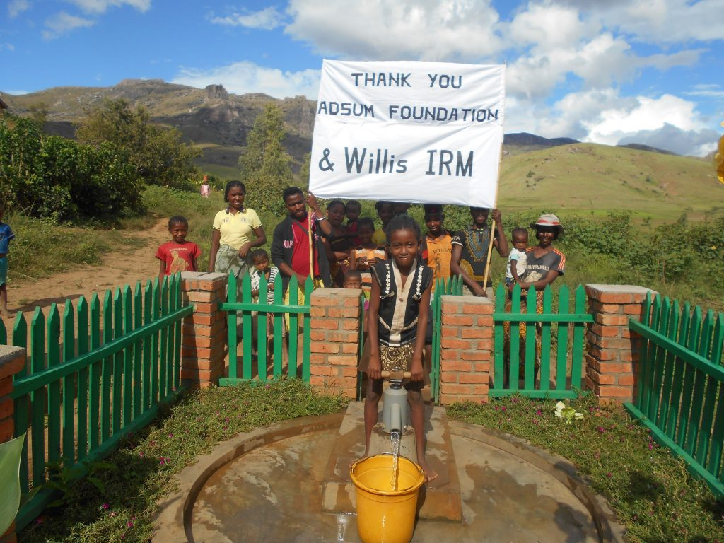 Villagers in Kivala, Madagascar draw water from a new well, built thanks to the fundraising efforts of staff at Willis Insurance and Risk Management (Willis IRM). Staff at the Belfast broker raised more than £15,000 to support the Adsum Foundation's work to install five fresh water wells in the Tsarakianja, Kivala and Tsirihimbolamena communities. Boreholes were dug and handpumps installed to provide clean water to around 700 people. The majority of money was raised in support of an attempt by Willis IRM Financial Services Director John Bedford to windsurf from Northern Ireland to Scotland in less than 90 minutes.