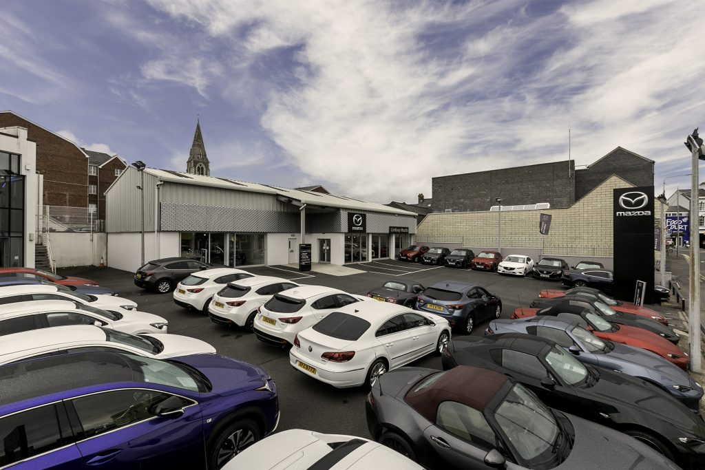 A highly-prominent car showroom site in Lisburn has been brought to market by leading property agency Lisney. The 4,033sq ft dealership at Market Place in the city, which is let to Ford Retail Ltd, trading as the Mazda brand, has an asking price of £650,000.