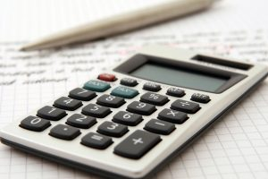 A calculator and pen indicate use by a professional for business purposes.