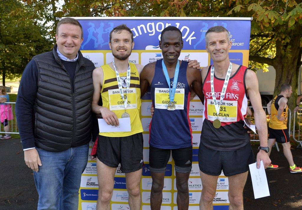 Stephen Patton, HR Manager of George Best Belfast City Airport with 2nd place winner of the Northern Ireland Ulster Championship Conan McCaughey, Winner of the Bangor 10K Gideon Kipsang and winner of the Northern Ireland Ulster Championship Declan Reed.
