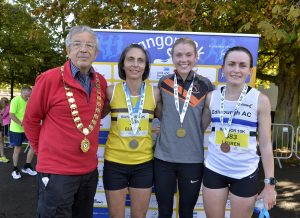 Ian Taylor President of Athletics NI presenting the female winners of the NI and Ulster Championship, 2nd place Gladys Ganiel with winner Emma Mitchell and Lauren Wilson who came 3rd