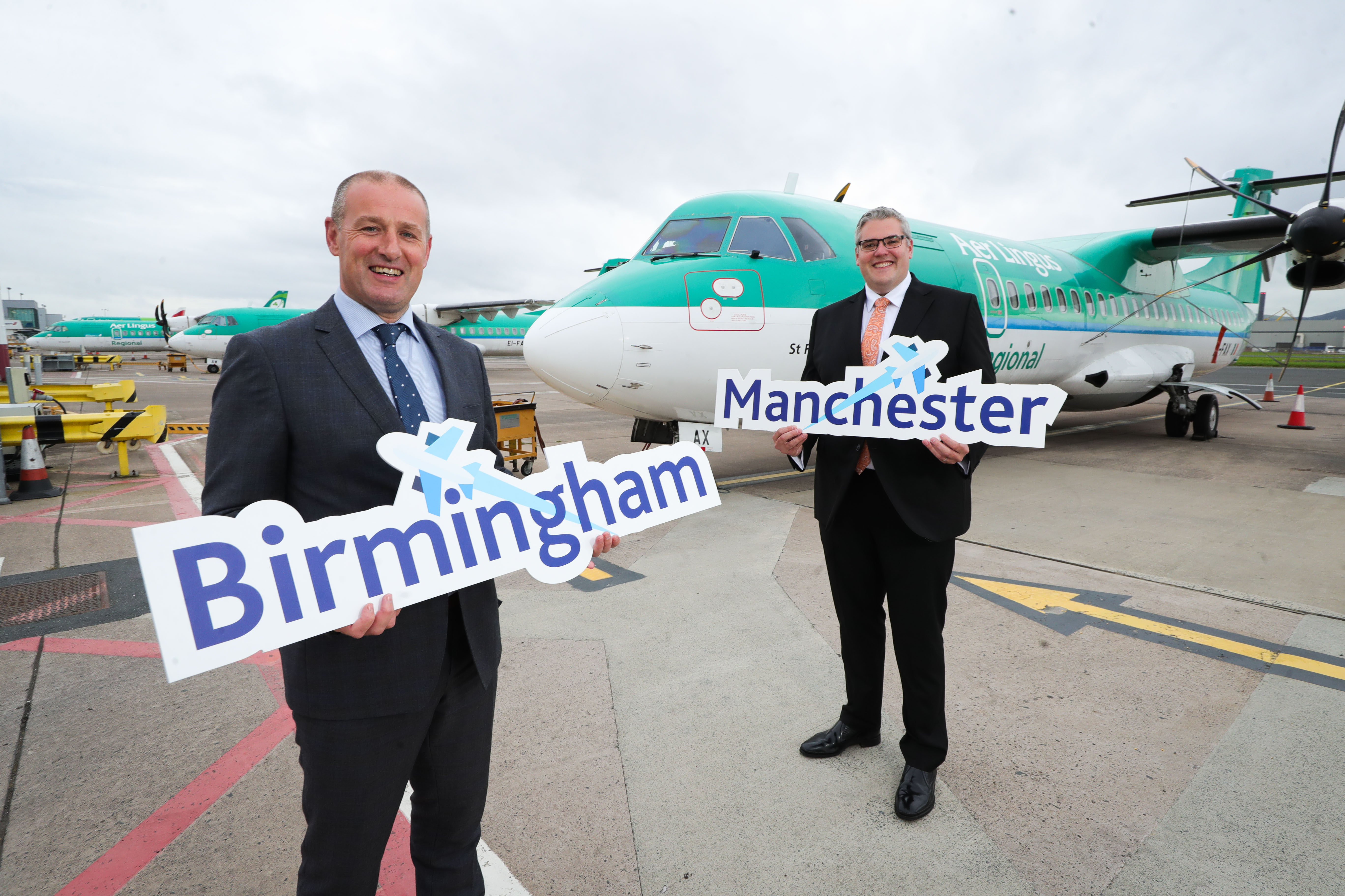 Mark Beattie, Operations Director, and East Belfast MP, Gavin Robinson, stand in front of an Aer Lingus Regional plane.