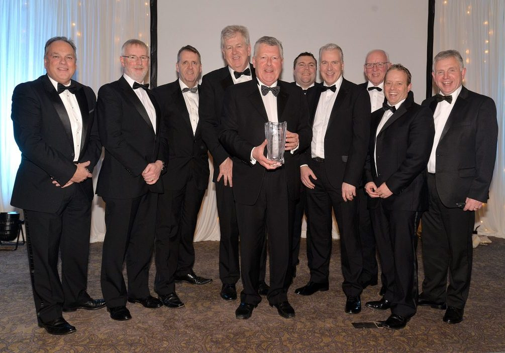 Terence Donnelly, front centre, winner of the Lifetime Achievement Award pictured with company staff at the awards night. INMU48-252.